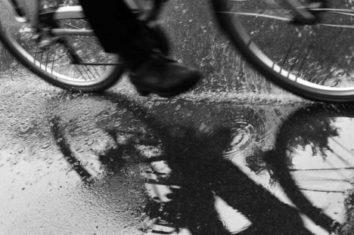 man riding his electric bike in the rain