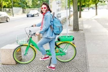woman getting ready to commute to work on hybrid bike