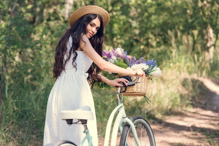 woman with a hybrid bike on the bike trails