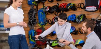 Parents shopping for a bike for their child