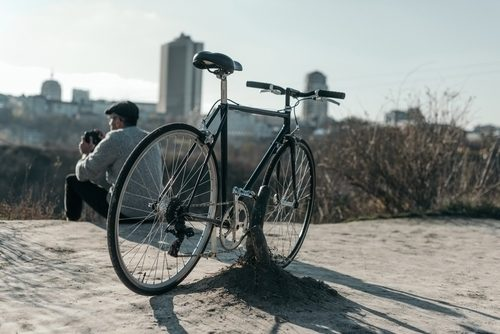 close up of hybrid bike with the city in the background