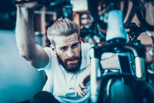 man thinking about what he wants before buying his mountain bike