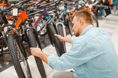 man comparing bikes