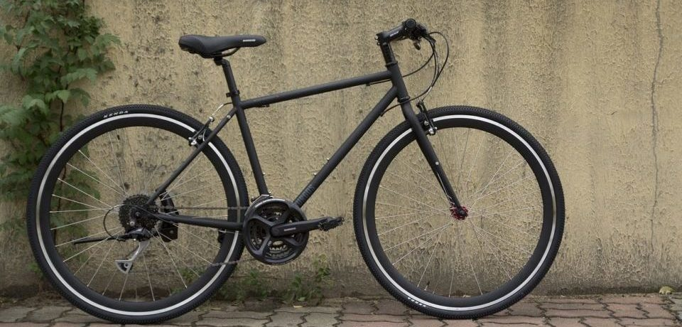 a bicycle reloaded from the brown wall banner image
