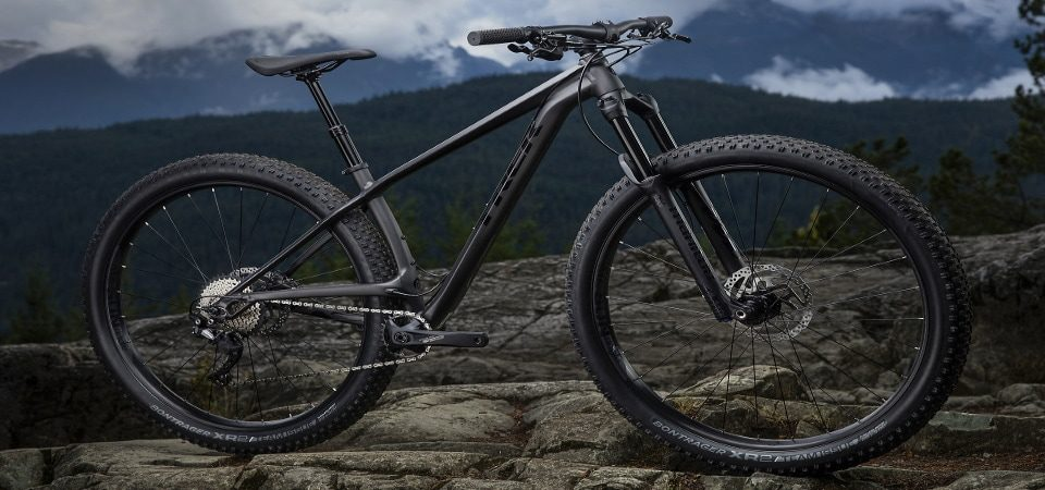 a black hardtail mountain bike on the hill