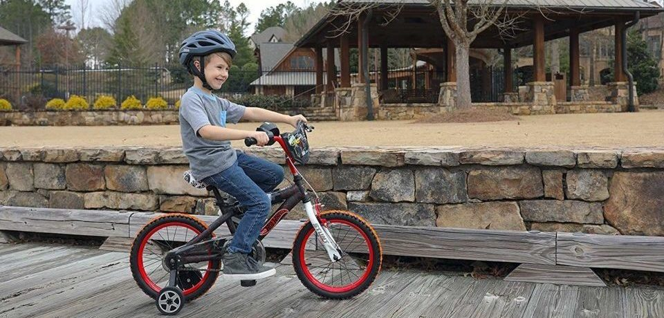 a boy riding his bike happily