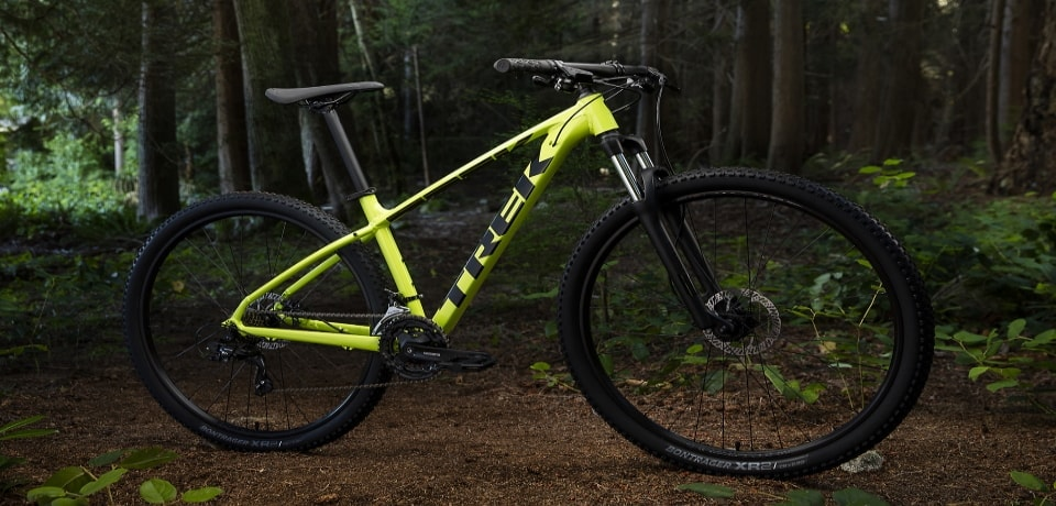 a cross country mountain bike at middle of the forest
