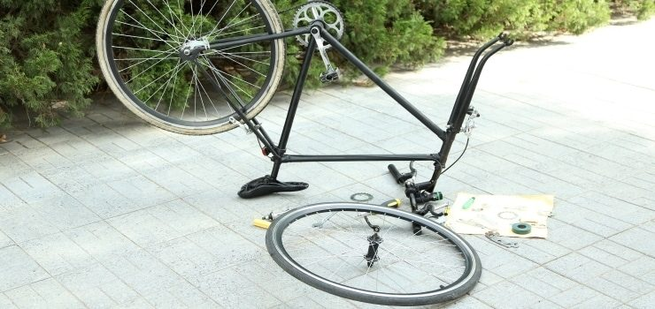 a disassembled bicycle on the ground