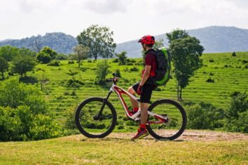 a guy on a mountain bike observing the landscape