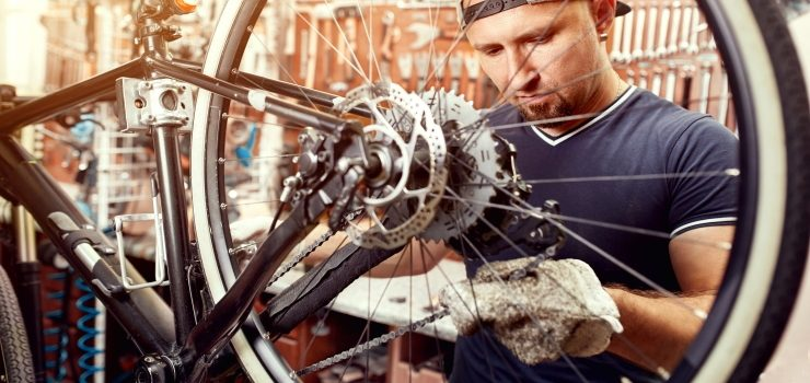 a man cleaning his bicycle chain