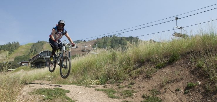 a man doing small jumps with a mountain bike