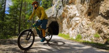 a man is riding on his bike at the forest featured image