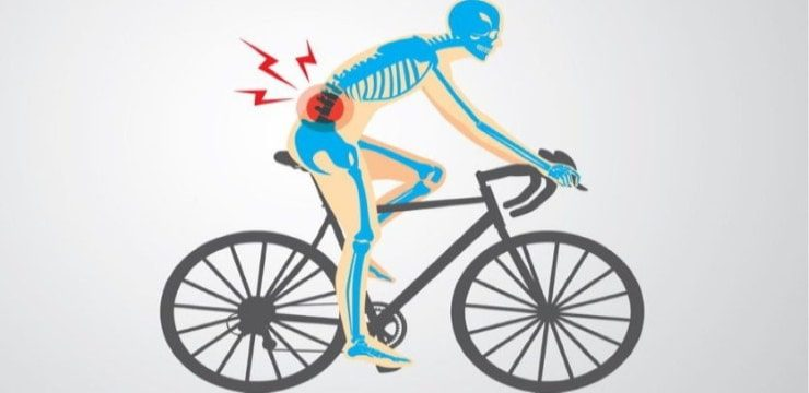 a man on a road bike showing an area of back pain