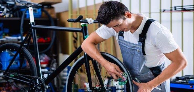 a man repair a road bike tire