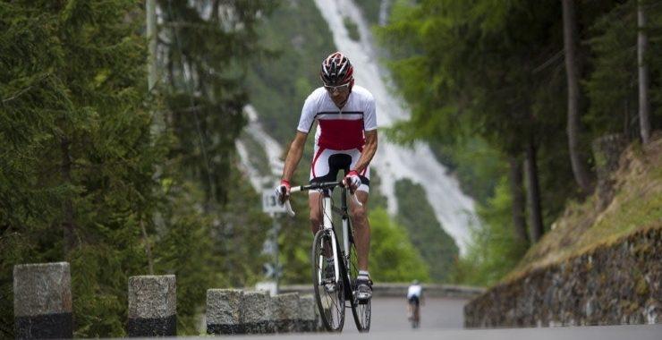 a man riding a road bike