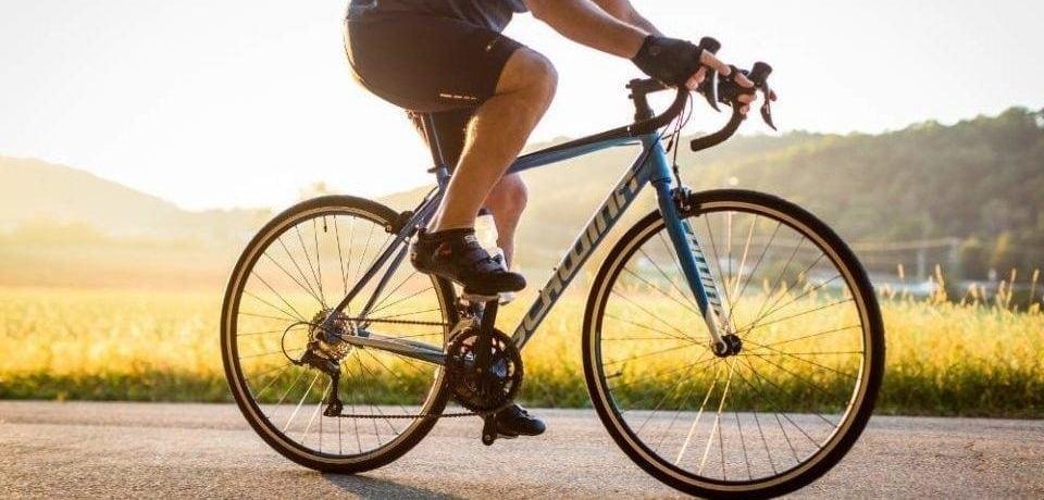 a man riding his blue bike