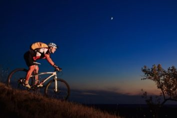 a man riding his mountain bike at night
