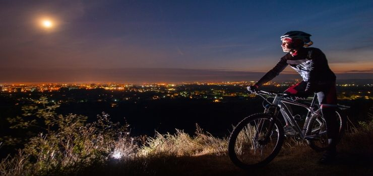 a man riding his mountain bike outside the city