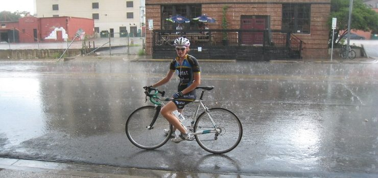 a person riding his bike on a wet floor