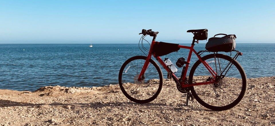 a red bike near the beach
