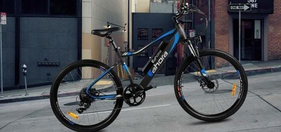 A black and blue electric mountain bike in the street