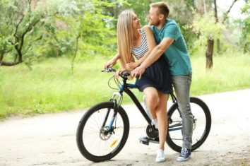 couple riding hardtail mountain bike
