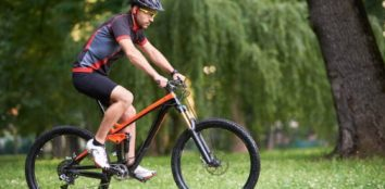 man enjoying morning riding his full suspension bike
