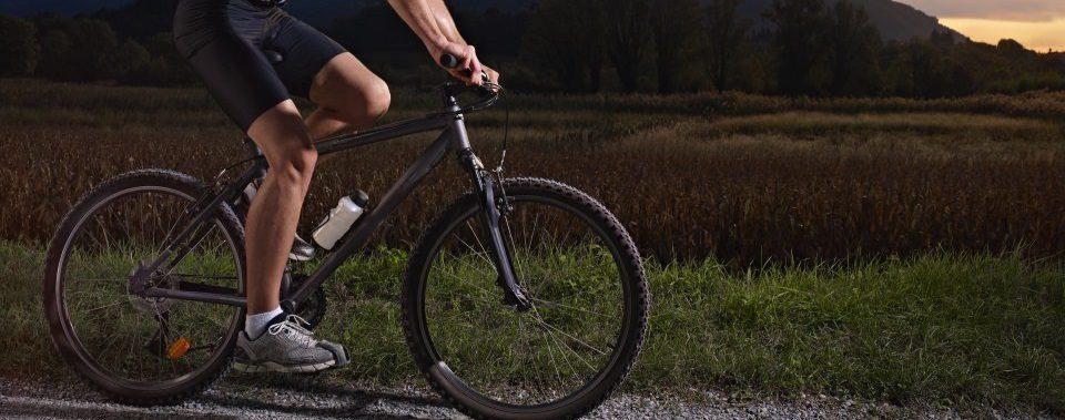 young man training on a mountain bike